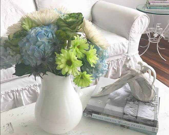 soft-home-furnishings-flowers-books-shabby chic slipcovered couch